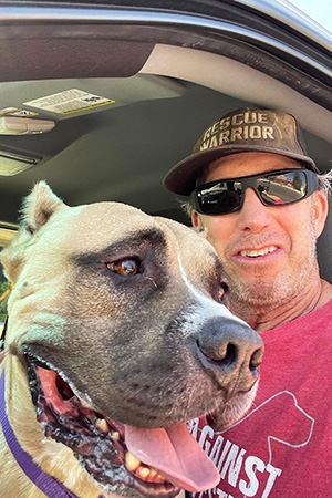 Volunteer Danny Bress ready for a ride in his truck with Beefy the dog