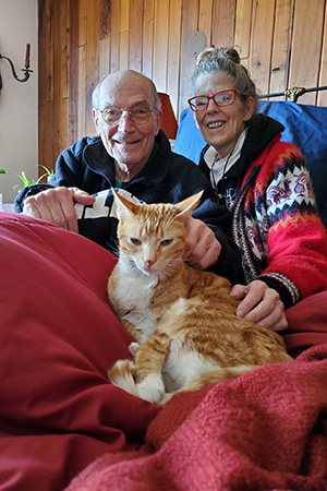 Newton the cat with his new family