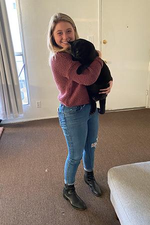 Woman holding Kent the black cat