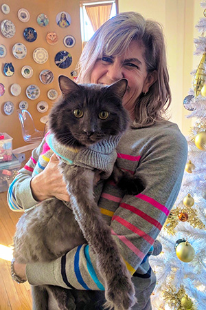 Woman holding Elroy the cat