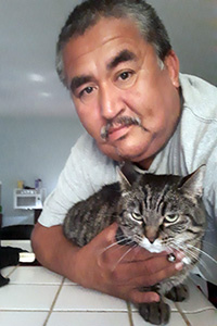 Armando with Sassy the brown tabby cat