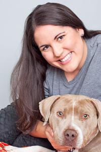Christine Quesada holding a dog
