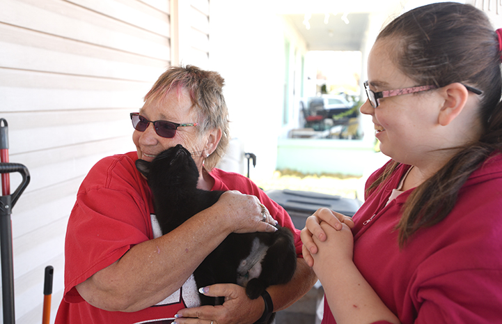Not all community cats are feral. Some learn to trust their people ― like colony caregiver Cindy Hide, who embraces Blackie after her spay surgery