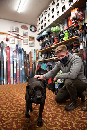 Dakota the dog in a ski shop with a person