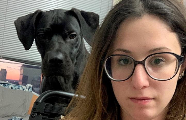 Selfie of Rachel with Milo the dog