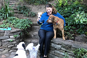 Tammy Hilbrich with Spartacus and her other dogs at home in a garden
