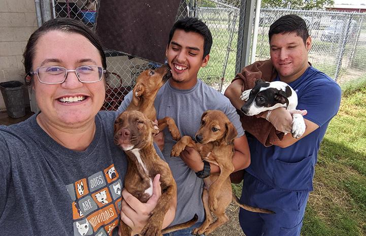 Terran, Joey and Jason holding puppies