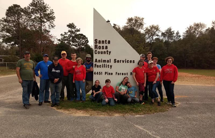 Group of people in front of the Santa Rosa County Animal Services sign