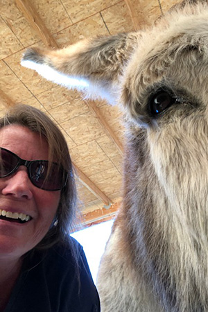 Selfie of Lauri and Speedy the donkey