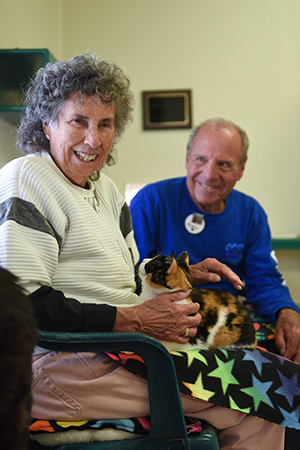 Marty and Brenda Winnick typically spend most of their time volunteering at Cat World, including some time with Ariel on Brenda's lap