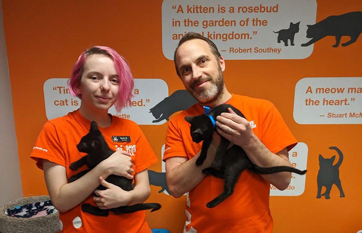 Bella and Justin Brodie, volunteers at the Best Friends Lifesaving Center in Salt Lake City, holding black kittens