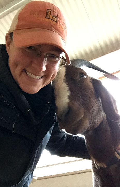 Caregiver Monica with Stevie the goat