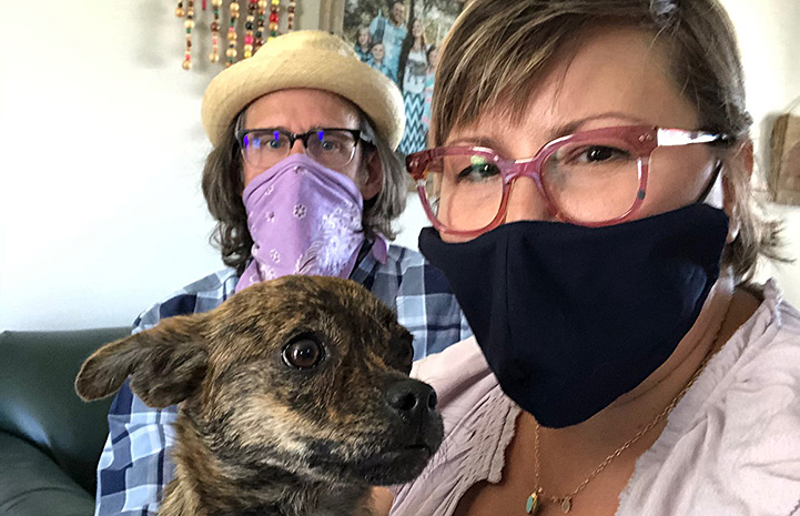 Mustard with her foster parents, Amanda and Gary