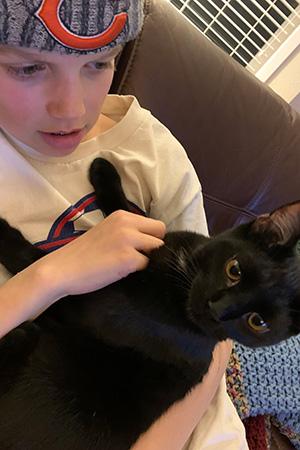Lucas snuggling with VGK the kitten