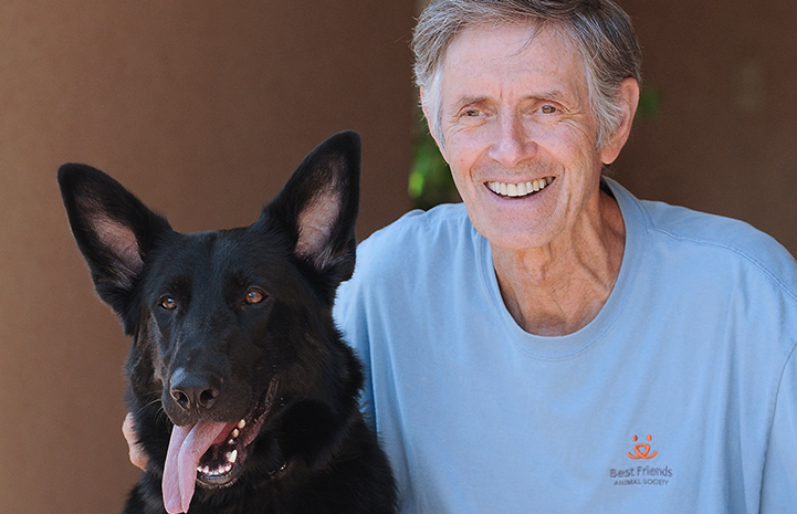 Gregory Castle with black German shepherd