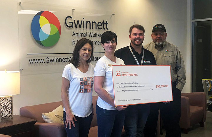 People holding a giant $50,000 check from Best Friends to Gwinnett County Animal Welfare and Enforcement in the Atlanta, Georgia