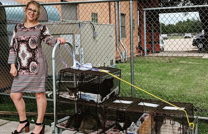 Lauren Miller pulling a cart covered in humane traps containing community cats