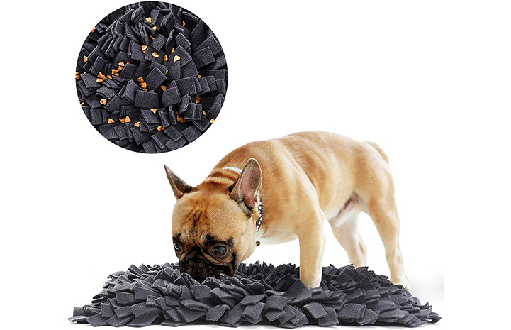 Brown French bulldog smelling a Snuffle Mat