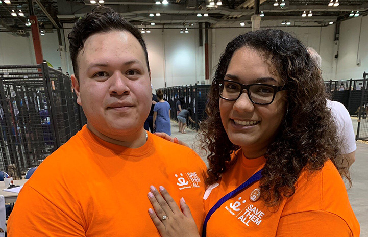Couple wearing orange Best Friends T-shirts got engaged at the Houston Super Adoption event