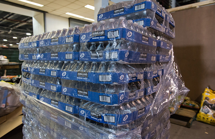 Cases of water were donated after Hurricane Harvey