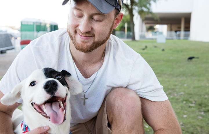 Dakota Jones went home just about the cutest black and white dog with a huge smile