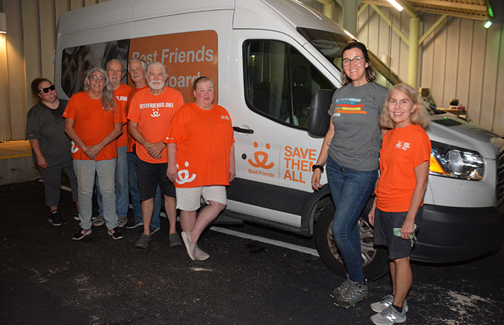 Best Friends staff and volunteer transporters to San Antonio with a van behind them