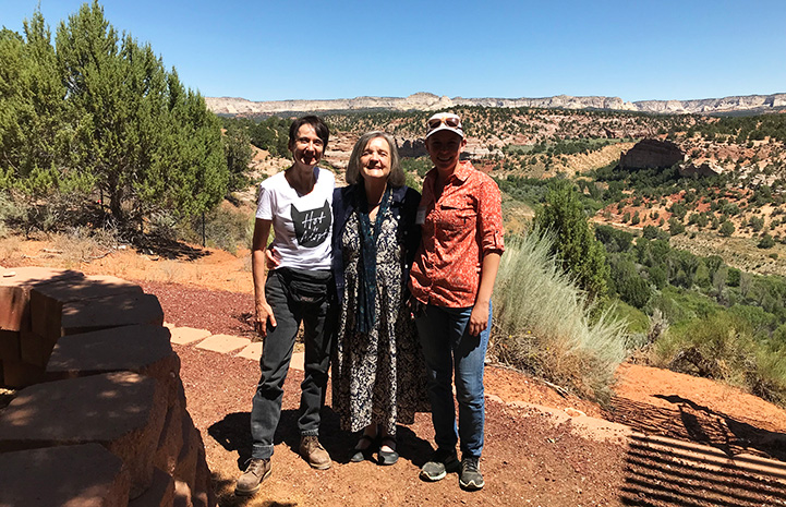 Donna Cerio standing with Faith Maloney and another person in front of Angel Canyon
