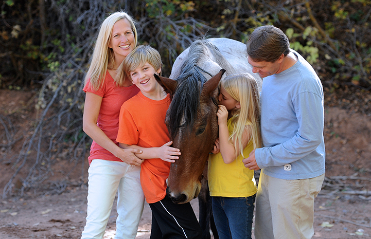 The Scharf family volunteering at Horse Haven in 2012