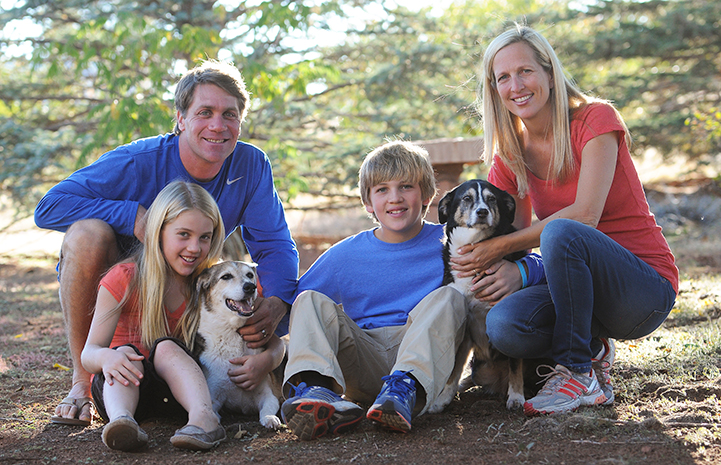 The Scharf family posing with two dogs from their 2012 trip
