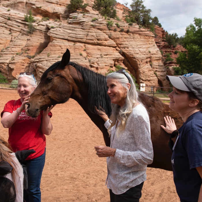 Best Friends founder Jana DePeyer with group at the Sanctuary