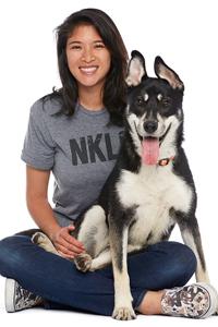 Jane Jetabut sitting with a dog