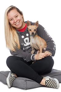 Jessica Schonberg sitting with a dog