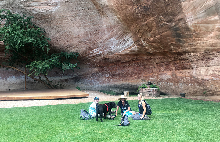 Jen and her family with a dog at Angels Landing