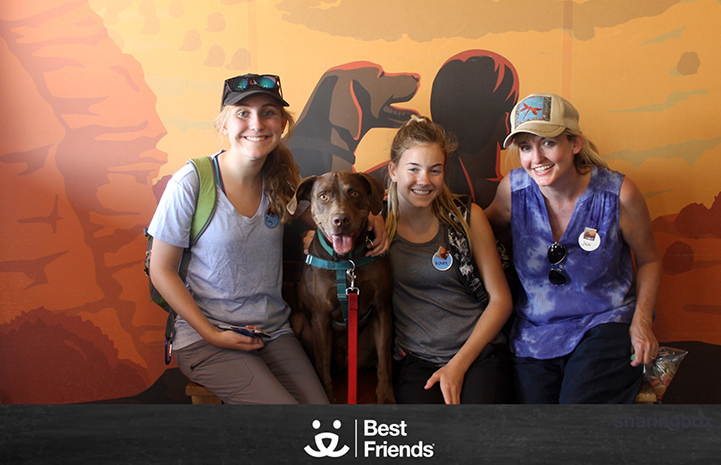 Jen, Ashley, Maddy and a brown dog at the Best Friends Visitor's Center