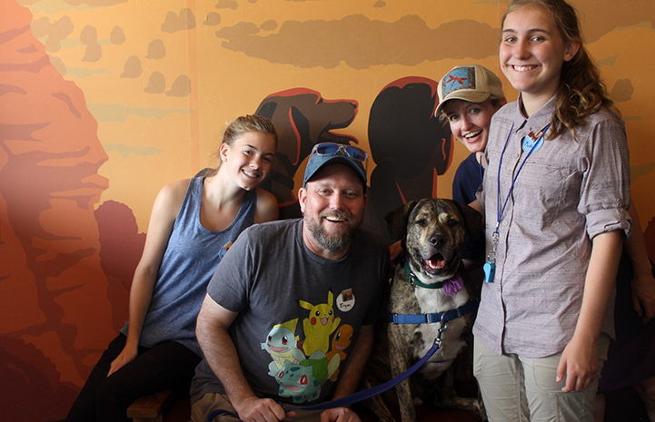 Jen, Bryan, Ashley and Maddy posting for a photo at the Best Friends Visitor's Center with a dog