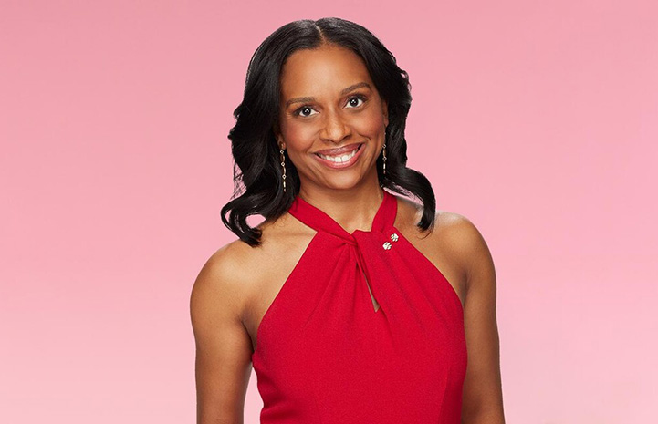 Head shot of Dr. Callie Harris (Foley), DVM smiling and wearing a red top