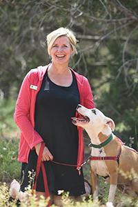 Karen Gallardo with a dog