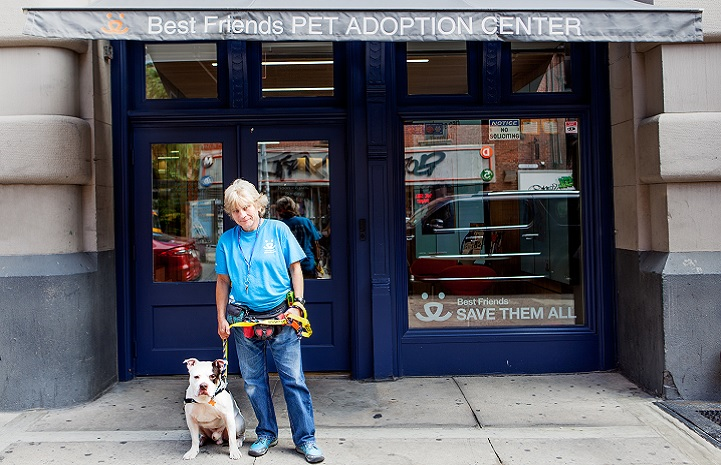 Kathy Posekel and dog in front of Best Friends Lifesaving Center in NYC