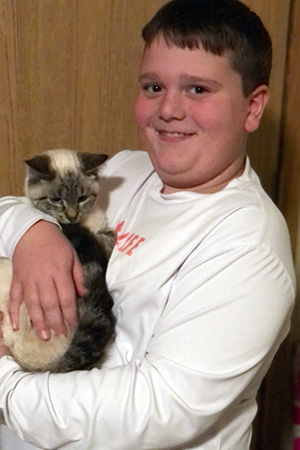 Camden holding Lucky the kitten