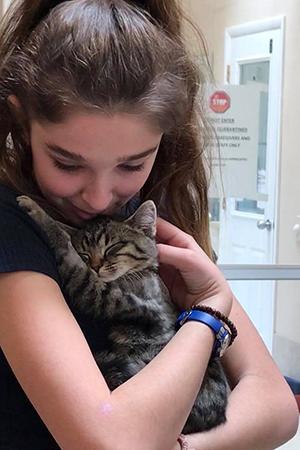 Mariah holding Cedar the kitten