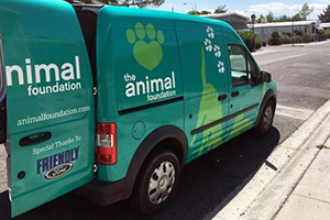 A teal colored van for The Animal Foundation
