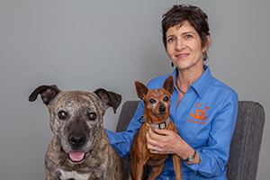 Monica Krieger with two dogs