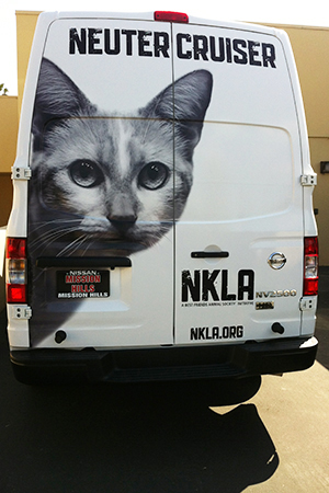 Cat face graphic on back of NKLA van