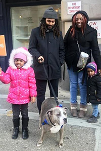 The Reeves family adopting Bertha the pit bull terrier