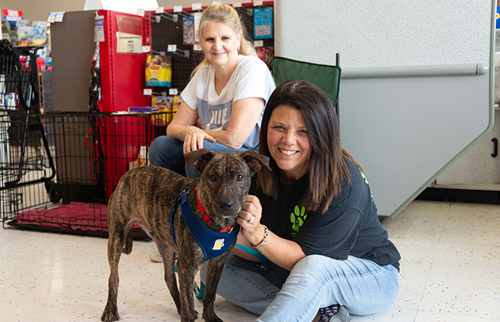 Two women with a dog from Rockwall Pets
