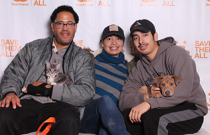 Puppy and kitten being adopted together by a family at the New York Super Adoption