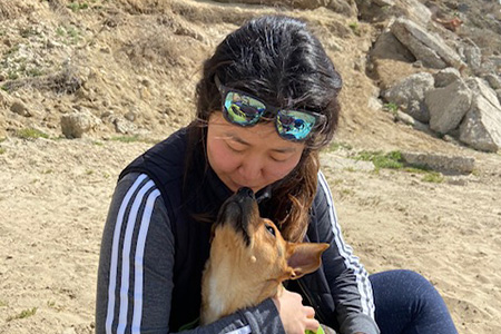 Lizzo the dog and her person snuggling at the beach
