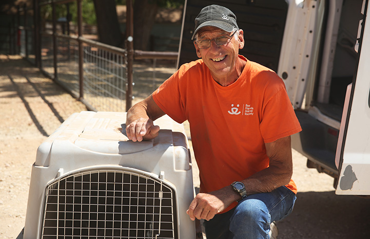 Don Clark next to the crate containing Mary Jane the pig
