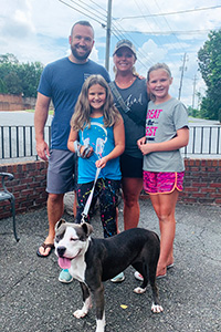 The Estle family with Roxy the dog