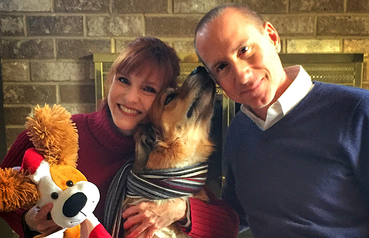 Matt Lallo and Paula Sessa with Lego the dog and a plush stuffed animal